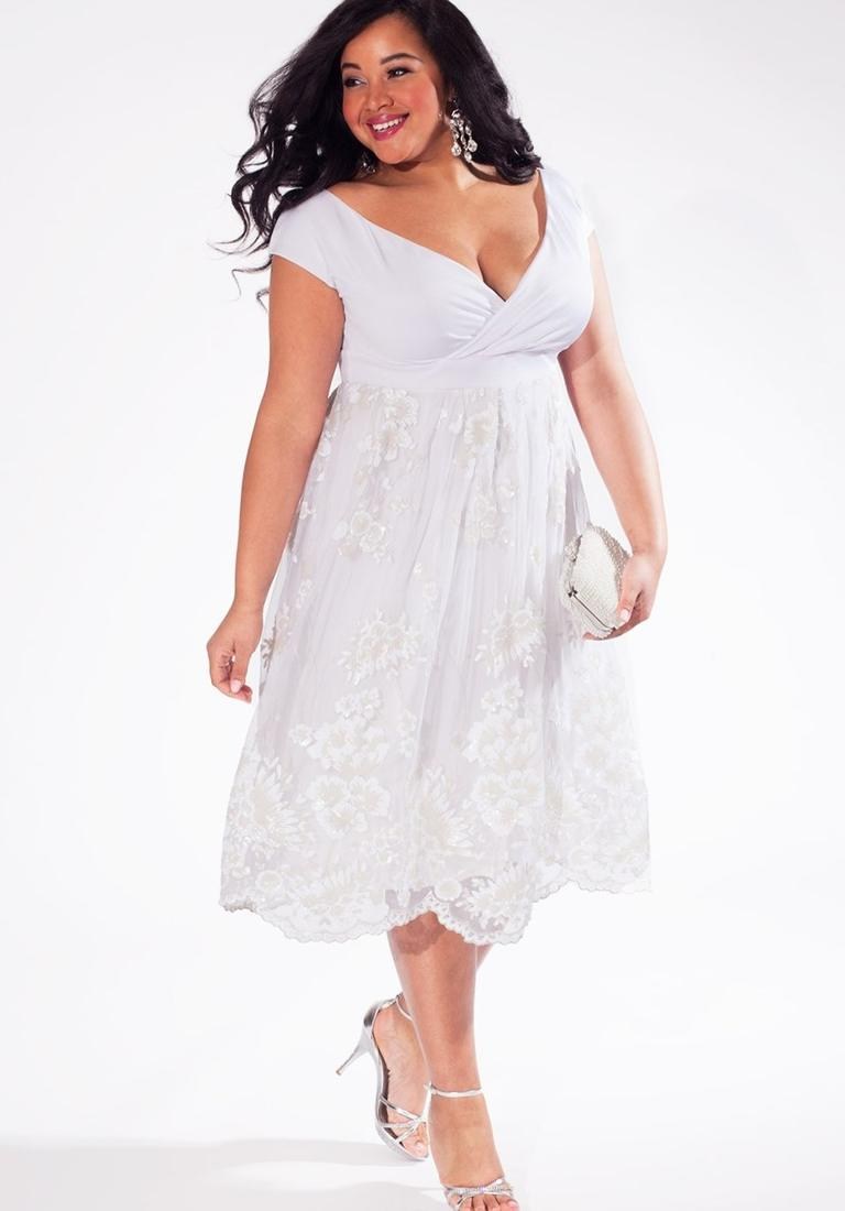 Plus size dress in white bridal boutique