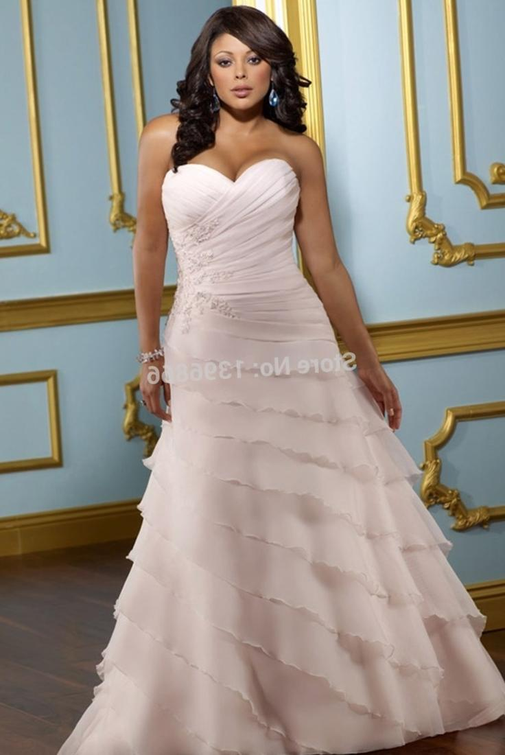 Strut Bridal Salon has the largest selection of blush pink and champagne plus size wedding dresses in our bridal boutiques. We specialize in one on one