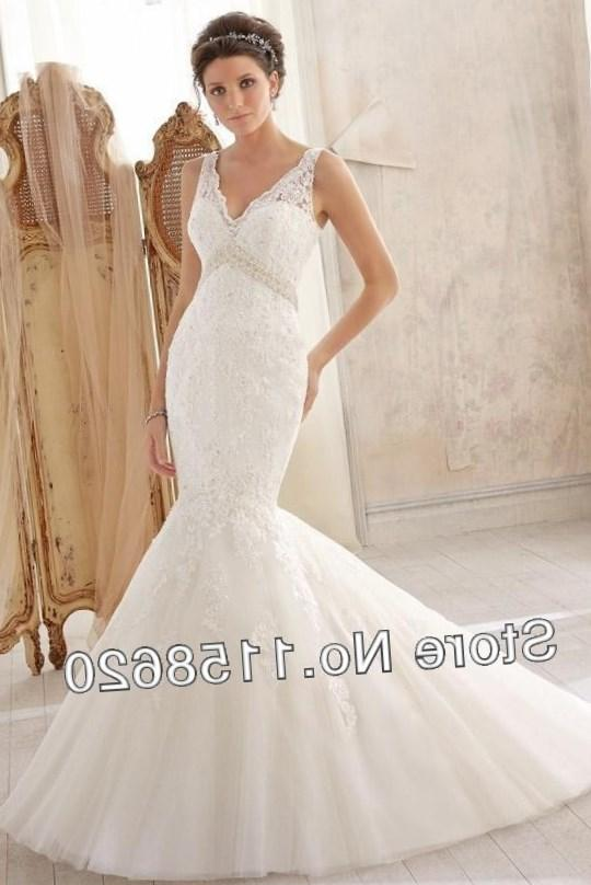 Brides who want to show off their hourglass figure can choose a strapless wedding gown that has a built-in corset. The corset helps to define the waistline,
