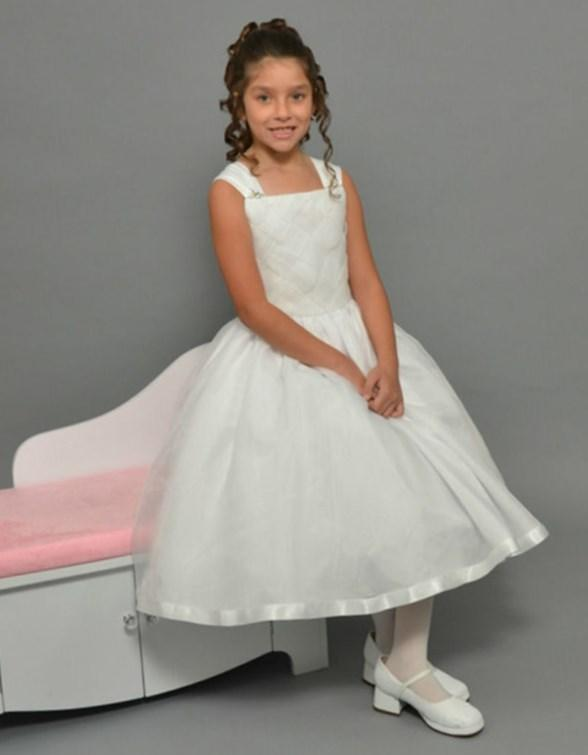 Pretty Chiffon first communion dress is fully lined, sleeveless with a satin bodice and zipper back. Made in the USA and available in sizes 6-12 and plus