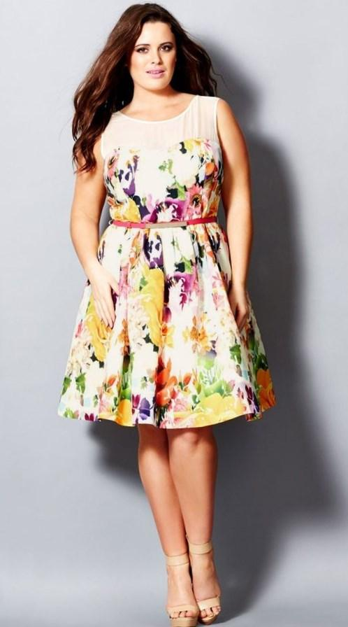 Look sweet in our enchanting Garden Party Dress at your next soiree. Covered in an