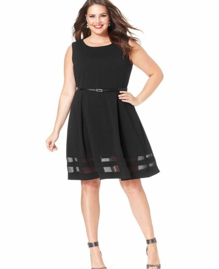 A short black skater dress with a waist belt