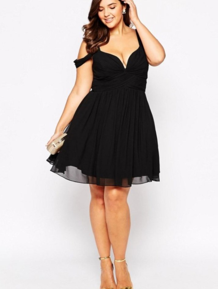 Black skater dress paired with gold accessories